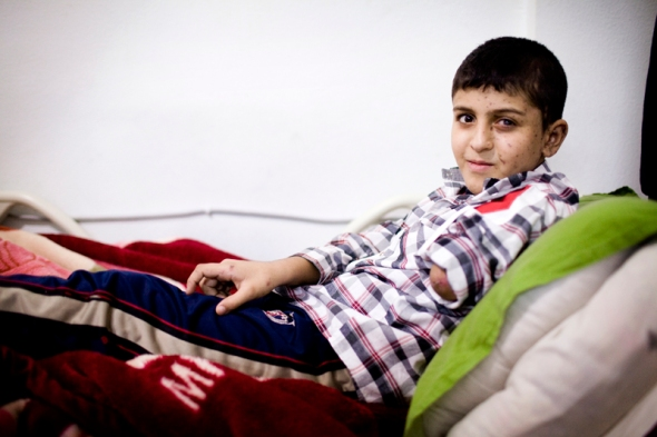Khalid is six years old. He was hit by one of the many bombs falling on Aleppo these days. He lost his left arm and half his foot and is itching all over. The doctor thinks it might be due to an infection in his blood. Looking at his face it's clear that it was his left side that was hit the worst. A whole life lies in between these two expressions.