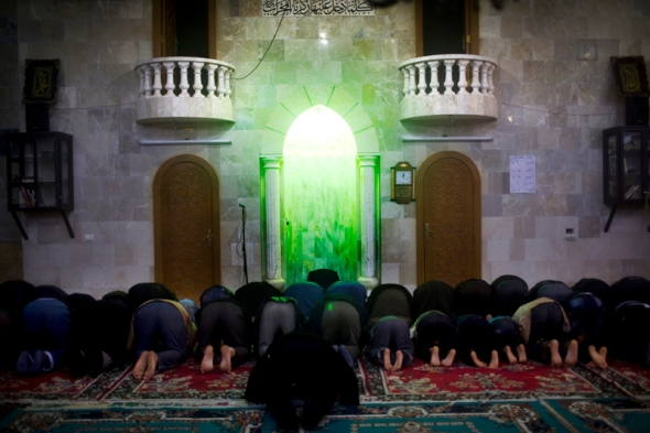 The many Muslims in the camp pray in the local mosque.