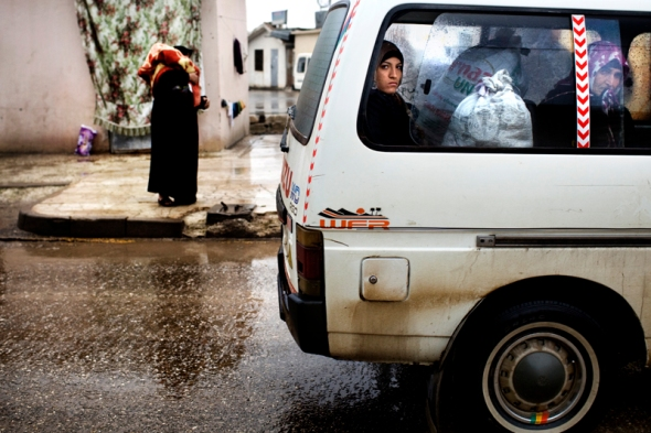 Two women are crossing the border into Syria from Turkey with a van full of supplies.